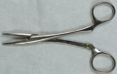 Four pairs of artery forceps.