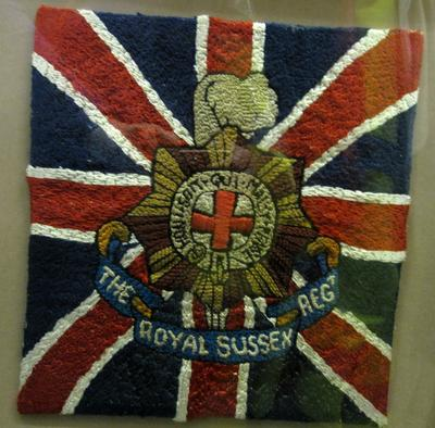Embroidery of the Regimental badge of The Royal Sussex Regiment