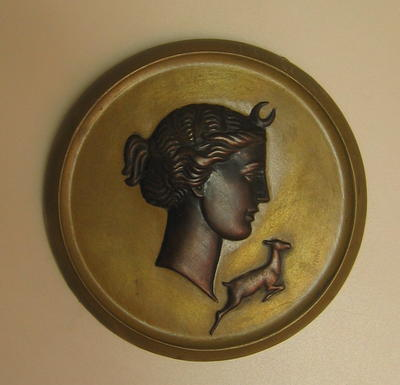 plaque of the head of the Goddess Diana with a deer