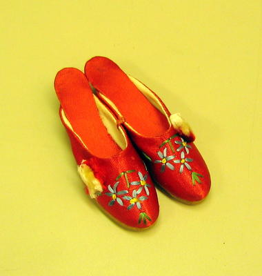 Pair of small, decorative red satin shoes