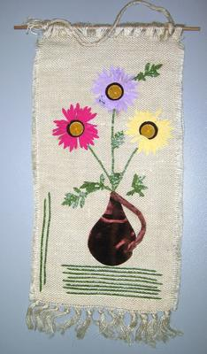 Woven wall hanging with applique motif of flowers on hessian: Fed Republic of Germany