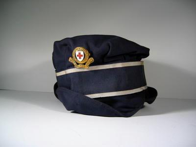 gabardine cap with ribbon and gilt badge