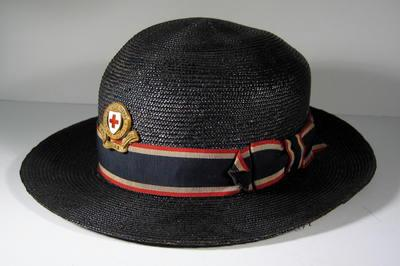 Navy straw hat with red/white/blue riband and gilt hat badge