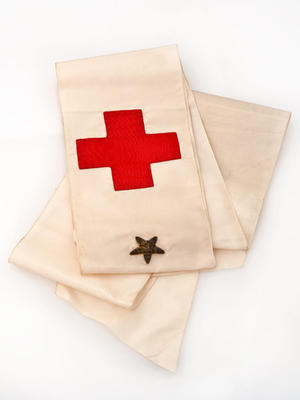 Silk sash with Red Cross emblem and embroidered gold star