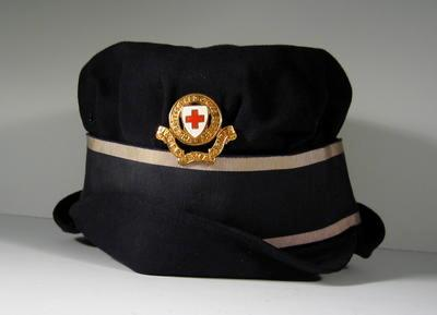One female navy gabardine peaked cap, with member's riband and gilt badge.