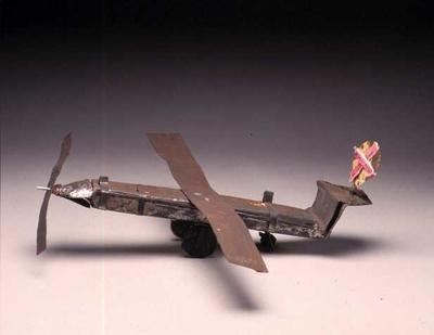 Model Pilatus aeroplane, made in Ethiopia, from a butter oil tin