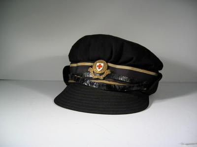 British Red Cross navy blue female gabardine cap, manufactured by Scott and Co with member's riband, hat badge and leather strap