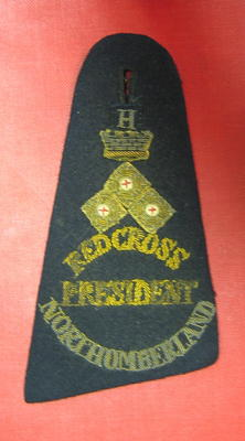 shoulder straps with insignia for County President: Red Cross/President/Northumberland with three embroidered metal pips, embroidered crown and letter H [Honorary?].