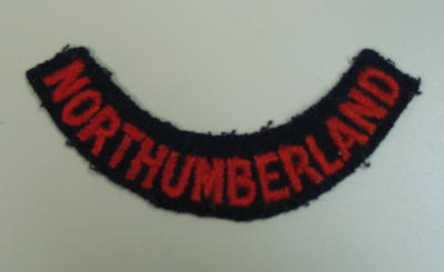 Cloth flash for outdoor uniform (red on black): Northumberland