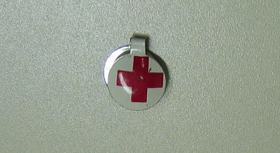 Small metal clip, white with the emblem.