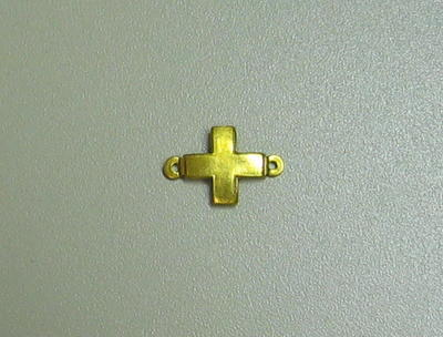 Small gilt emblem in the form of a Geneva Cross, attached to the Voluntary Medical Services medal, used to denote an additional 20 years award,
