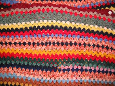 Multi-coloured crocheted blanket