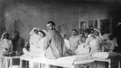 Members of the Berry Unit attend to dressings in a treatment room of the Anglo-Serbian Hospital, Serbia