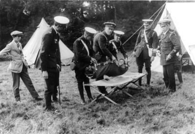 Members of Surrey/39 (Godalming) practising carrying casualty in blanket stretcher at Busbridge Camp