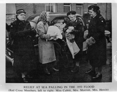 Black and white photograph showing members providing relief after a flood