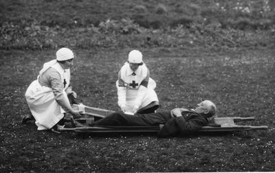 Black and white photograph showing first aid practice