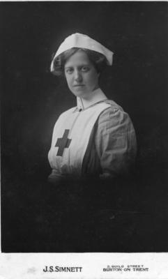 Studio portrait of Florence Egerton in Red Cross uniform with a Sister Dora cap