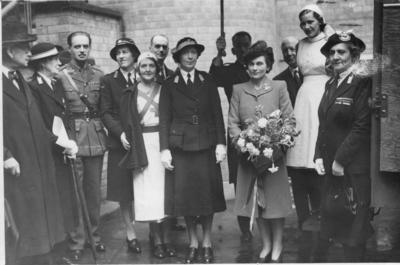 Mrs Dixon with group at a ceremony
