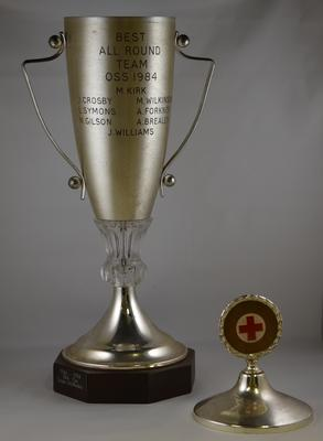 Competition cup on wooden base engraved 'Best All Round Team OSS 1984'