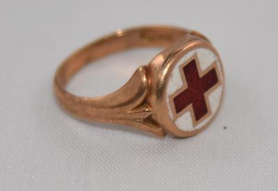 Gold ring featuring Red Cross emblem