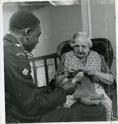 British Red Cross volunteer visiting a person at home