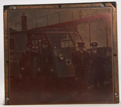 Photographic printing block with the image of an ambulance and Red Cross personnel