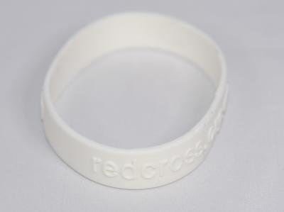 Branded white rubber wristband: 'Power of Humanity' campaign