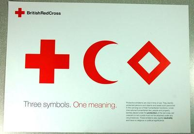 small poster showing the three emblems of the Red Cross movement