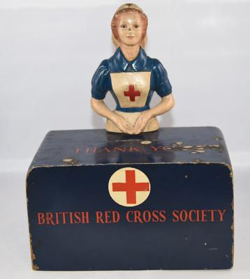 Wooden collecting box featuring female VAD figure in uniform.