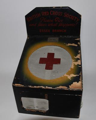 Red Cross collecting box with record player inside.
