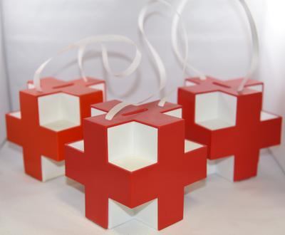 Set of three plastic collecting boxes in the shape of the Red Cross emblem