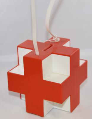 Plastic collecting box in the shape of the Red Cross emblem