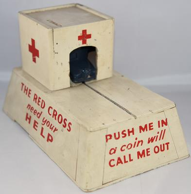British Red Cross mechanical collecting box with roll out model ambulance: 'Push me in - a coin will call me out'