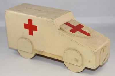 Wooden collecting box in the shape of an ambulance.