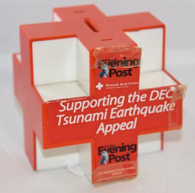 DEC Tsunami Eathquake Appea plastic collecting box in the shape of the Red Cross emblem