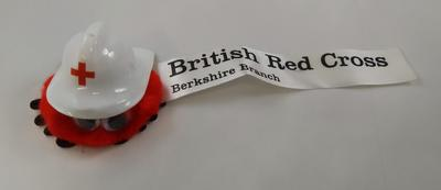 Small promotional souvenir logobug with plastic hard hat: 'British Red Cross. Berkshire Branch'