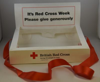 Plastic collection tray: 'It's Red Cross Week. Please give generously'