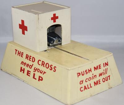 British Red Cross mechanical collecting box with roll out model ambulance : 'Push me in - a coin will call me out'; Fundraising/collecting box; 287/14/3(2)