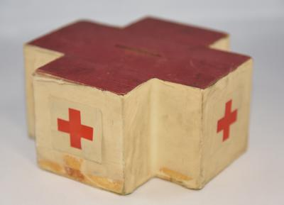 Wooden collecting box in the shape of the Red Cross emblem