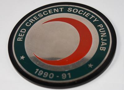 Circular plaque: Red Crescent Society Punjab 1990-91