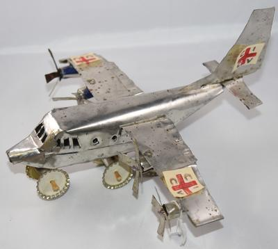 Model Red Cross aeroplane made from cooking oil tins by children in Angola