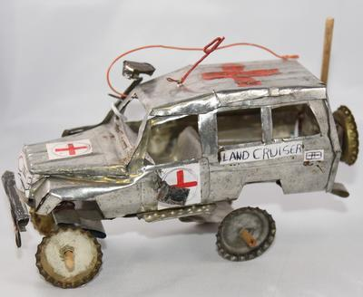 Model Red Cross small land cruiser made from cooking oil tins