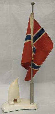 Ivory model featuring penguin next to Norwegian flag