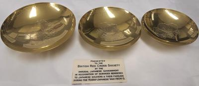 A set of three decorative gold bowls, presented by the Imperial Japanese Government in recognition of services rendered during the Russo-Japanese War 1904-5