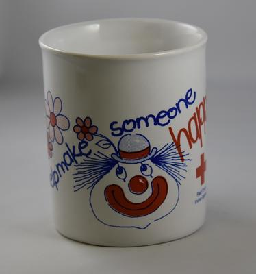 China mug: The Red Cross Irvine Appeal, 'Make Someone Happy.'