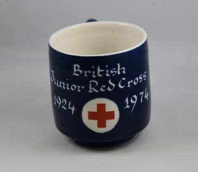 "Blue ceramic mug: ""British Junior Red Cross 1924-1974"" produced to commemorate the Junior Red Cross Jubilee"