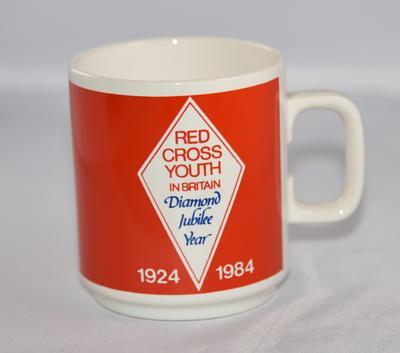 "Ceramic ""Red Cross Youth in Britain Diamond Jubilee Year 1924-1974"" mug."