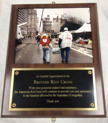 A framed photograph and plaque given in appreciation for help by British Red Cross Society after 9/11 from The American Red Cross.