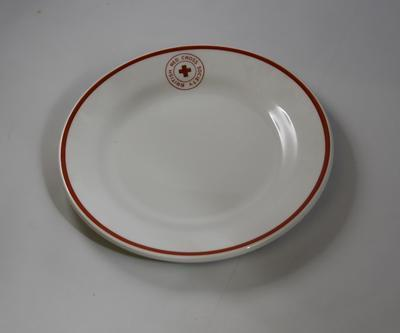 Branded plate: British Red Cross Society with red line around edge