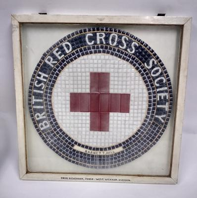 Framed mosaic featuring the Red Cross emblem